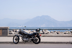 Motorbike in Bay of Naples; Italy; View of Vesuvius