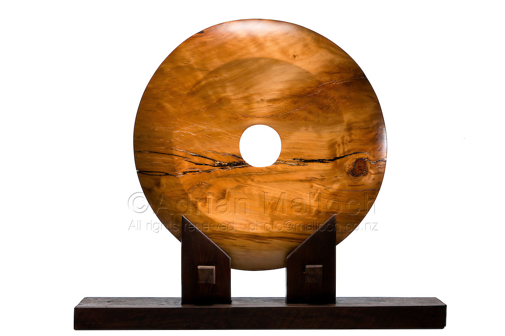 Sculpture from a commissioned series of photographs of Te Hana sculptor Kerry Strongman who specialises in monolithic works made from tens of thousands of years old swamp kauri.
