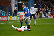 Carlisle United Defender Tom Miller trips Everton midfielder Bryan Oviedo  during the The FA Cup fourth round match between Carlisle United and Everton at Brunton Park, Carlisle, England on 31 January 2016. Photo by Craig McAllister.
