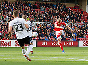 Middlesbrough midfielder George Saville (22) fires a shot onto the Swansea crossbar during the EFL Sky Bet Championship match between Middlesbrough and Swansea City at the Riverside Stadium, Middlesbrough, England on 22 September 2018.