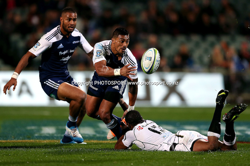 Pita Ahki of the Blues offloads against S'bura Sithole of the Sharks. Super Rugby rugby union match, Blues v Sharks at North Harbour Stadium, Auckland, New Zealand. Friday 23rd May 2014. Photo: Anthony Au-Yeung / photosport.co.nz