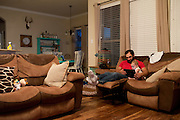 Johny Hendricks watches videos on his iPad with his eight-month-old daughter, Avin, at their home in Midlothian, Texas on February 27, 2014.