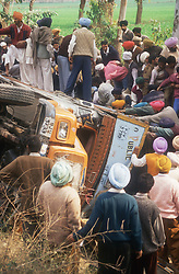 Road accident in the Punjab; India; near Patiala; with crowd of people surrounding overturned lorry,