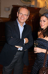 LORD ARCHER and KATIE NICHOLL at a party to celebrate the publication of Wicked - A Tale of Two Schools by Jilly Cooper held at Westminster School, Dean's Yard, London on 11th May 2006.<br />