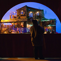 "VERONA, ITALY - DECEMBER 04:  A visitor admires one ""presepe"" at the exhibition  of nativity scenes from all over the world inside the passage ways of the Roman Arena. on December 4, 2010 in Verona, Italy. Christmas markets, fairs, lights and nativity scenes fill Northern Italian cities and villages from December through January 6."