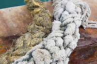 Worn rope used to tie up boats on the Aran Islands in Galway Ireland