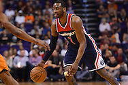 Apr 1, 2016; Phoenix, AZ, USA; Washington Wizards guard John Wall (2) handles the ball against the Phoenix Suns at Talking Stick Resort Arena. The Washington Wizards won 106- 99. Mandatory Credit: Jennifer Stewart-USA TODAY Sports