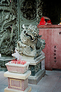 Malaysia, Georgetown. Lion at the gate of a Chinese temple in Georgetown.