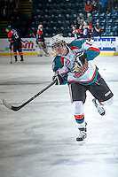 KELOWNA, CANADA - DECEMBER 27: Tate Coughlin #15 of the Kelowna Rockets takes a shot during warm up against the Kamloops Blazers on December 27, 2013 at Prospera Place in Kelowna, British Columbia, Canada.   (Photo by Marissa Baecker/Shoot the Breeze)  ***  Local Caption  ***