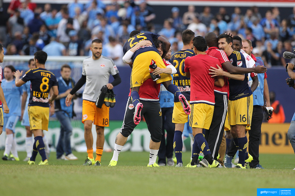 New York Red Bulls players celebrate their 3-1 victory at the final whistle during the New York City FC Vs New York Red Bulls, MSL regular season football match at Yankee Stadium, The Bronx, New York,  USA. 28th June 2015. Photo Tim Clayton