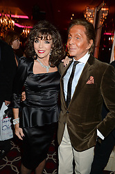 JOAN COLLINS and VALENTINO at a party to celebrate the publication of 'Passion for Life' by Joan Collins held at No41 The Westbury Hotel, Mayfair, London on21st October 2013.