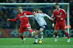 PRESTON, ENGLAND - Saturday, January 3, 2009: Liverpool's Lucas Leiva and Preston North End's Ross Wallace during the FA Cup 3rd Round match at Deepdale. (Photo by David Rawcliffe/Propaganda)