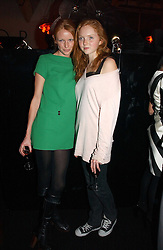 Left to right, models OLIVIA INGE and LILY COLE at a party to celebrate the launch of a range of leather accessories designed by Giles Deacon for Mulberry held at Harvey Nichols, Knightsbridge, London on 30th October 2007.<br />