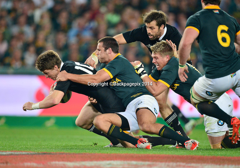 Beauden Barrett of New Zealand tackled by Jan Serfontein of South Africa during the Castle Lager Rugby Championship match between South Africa and New Zealand at Ellis Park on 04 October 2014 © Gavin Barker/BackpagePix