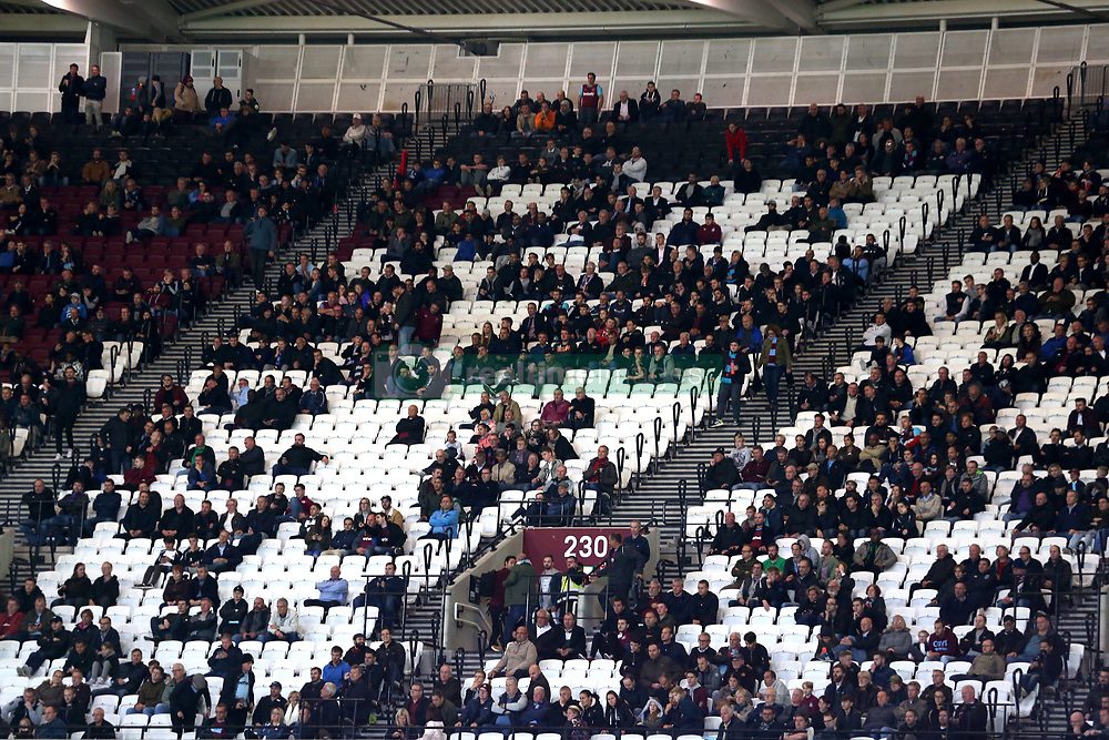 Empty seats amongst the West Ham United fans after Brighton & Hove Albion's Glenn Murray scores his side's third goal of the game