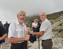 Meet on the reek....Tom Feehan from Kilmeena and James Heraty from Aghagower amoung the many thousand that made their way to the summit of Croagh Patrick on sunday last.<br /> Pic Conor McKeown