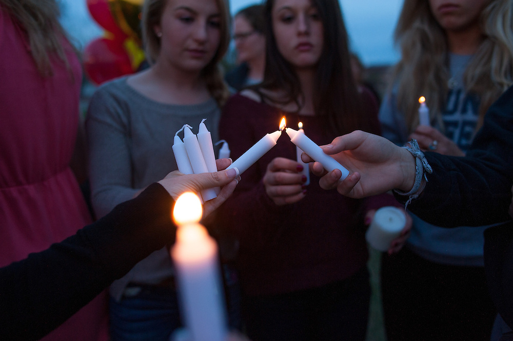 Students and friends of German exchange student, Diren Dede, who was slain on April 27, 2014, light candles at his vigil on May 2, 2014 at the Fort Missoula soccer field where Dede played.