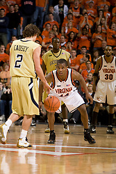 Virginia guard Sean Singletary (44) sets on defense against Georgia Tech guard Matt Causey (2).  The Virginia Cavaliers men's basketball team fell to the Georgia Tech Yellow Jackets 92-82 in overtime at the John Paul Jones Arena in Charlottesville, VA on January 27, 2008.