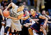 SHOT 2/14/13 8:25:19 PM - Arizona's Mark Lyons #2 plays defense on   Colorado's Spencer Dinwiddie #25 during their regular season Pac-12 basketball game at the Coors Event Center on the Colorado campus in Boulder, Co. Colorado won the game 71-58. (Photo by Marc Piscotty / © 2013)