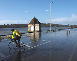 A cyclist turns around along the flooded Windsor Road in Egham, United Kingdom. Saturday, 8th February 2014. Picture by Max Nash / i-Images