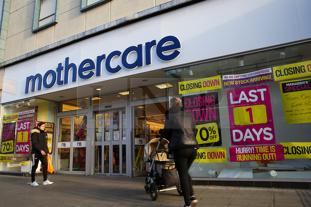 © Licensed to London News Pictures. 09/01/2020. London, UK. A woman with a pram outside a branch of mother and baby retailer, Mothercare, in Wood Green, north London which is to close in one day. All 79 Mothercare stores are set to close by Sunday 12 January 2020 - putting 2,500 people out of work after the company went into administration last year. Photo credit: Dinendra Haria/LNP