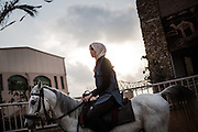 A girl is seen during a horse back riding lesson at the al Fares club at sunset, the club situated in the north of the Gaza strip is not far from the beach