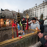 LONDON, ENGLAND - FEBRUARY 07:  Shiite Muslim devotees pay their respects at a replica model of a shrine of Karbala during  the 29th Arbaeen Procession on February 7, 2010 in London, England. Arbaeen occurs 40 days after the day of Ashura, the commemoration of the martyrdom of Imam Husain in Karbala  (Photo by Marco Secchi/Getty Images)