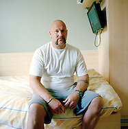 Halden Prison, Norway, June 2014:<br /> A prisoner in his cell. On the TV screen the prisoners can access internal prison info and a selection of TV channels. <br /> -- No commercial use --<br /> Photo: Knut Egil Wang/Moment/INSTITUTE