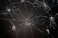 Broken glass pieced together on black background
