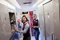 Florence, Italy - 28 April, 2012: Hostesses prepare coffee for first class passengers for the Milan bound ITALO, Europe's first private operator of high-speed, domestic trains in Italy, in Florence, Italy, on April 28, 2012. The company's president is Ferrari chairman Luca Cordero di Montezemolo, one of the shareholders along with other private entrepreneurs like luxury businessmen Diego Della Valle, the French railway company, Italy's largest retail bank and the country's largest insurer. Italy's NTV (Nuovo Trasporto Viaggiatori) is the first company in Europe to compete with the state-run Trenitalia on high-speed service. When at full regime at the end of the year, 25 innovative trains will connect nine Italian cities, from Salerno to Milan, from Turin to Venice at 300km per hour. Italo passengers will board on stable trains that do not rely on a locomotive car, but has engines underneath each of the 11 carriages to increase capacity as well as safety.<br /> <br /> Ph. Gianni Cipriano for The New York Times