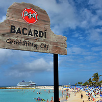 Bacardí Bar Sign at Great Stirrup Cay, Bahamas<br /> Most NCL Bahama cruises offer complimentary liquor. Those cocktails keep flowing at Great Stirrup Cay. The main place for adult refreshments is the Bacardí Bar where you can sip at shaded tables while listening to entertainment. If you prefer enjoying your drink at your chaise lounge, you can quickly order from either the Bertram's Bar or Patron Bar. As of this writing, plans are underway to be add a LandShark Bar & Grill sponsored by Jimmy Buffett's Margaritaville.