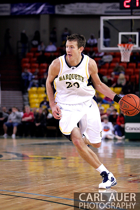 25 November 2005: Golden Eagle Steve Novak (20) drives down the court in the Marquette University 73-70 victory over Oral Roberts University at the Great Alaska Shootout in Anchorage, Alaska