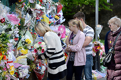 © London News Pictures. 25/05/2013. Woolwich, UK. People laying flowers at the scene where Drummer Lee Rigby was murdered by two men in Woolwich town centre in what is being described as a terrorist attack. Photo credit: Ben Cawthra/LNP