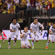 EAST RUTHERFORD, NEW JERSEY - JUNE 17: Colombia players react to David Ospina #1 of Colombia final save to win the penalty shoot out players include Juan Cuadrado #11, James Rodriguez #10, Dayro Moreno #17 and Sebastian Perez #13 of Colombia during the Colombia Vs Peru Quarterfinal match of the Copa America Centenario USA 2016 Tournament at MetLife Stadium on June 17, 2016 in East Rutherford, New Jersey. (Photo by Tim Clayton/Corbis via Getty Images)