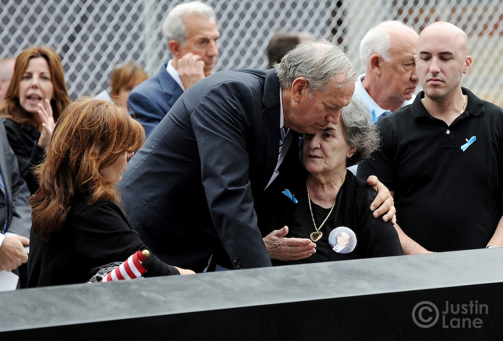 Former New York Governor George Pataki (C) embraces a woman at the side of the North Pool of the 9/11 Memorial during tenth anniversary ceremonies at the site of the World Trade Center September 11, 2011, in New York. POOL/Justin Lane/EPA
