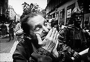 A street musician plays his harmonica on the Vaci Utca in Budapest,Hungary. ©1993