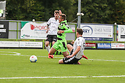 Forest Green Rovers Elliott Frear (11) is tackled by Bromley's Jack Holland(6) during the Vanarama National League match between Forest Green Rovers and Bromley FC at the New Lawn, Forest Green, United Kingdom on 17 September 2016. Photo by Shane Healey.