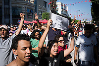 TUNIS, TUNISIA - 25 JULY 2013: People rallied in Avenue Habib Bourguiba in front of the Interior Ministry to protest against the assassination of opposition leader Mohamed Brahmi in Tunis, Tunisia, on July 25th 2013.<br /> <br /> Tunisia, birthplace of the Arab Spring revolutionary movement, was plunged into a new political crisis on Thursday when assassins shot Mohamed Brahmi, 58, leader of the Arab nationalist People's Party, an opposition party leader outside his home in a hail of gunfire.<br /> <br /> The assassination, which coincided with celebrations for the 56th anniversary of Tunisian statehood after independence from France, came as Tunisia was still grappling with a democratic transition following the January 2011 revolution that toppled the country's autocratic leader, Zine el-Abidine Ben Ali, and forced him into exile. The Tunisian revolution was the catalyst that spawned similar uprisings in Egypt, Libya, Yemen and Syria.