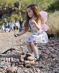 European Stone Stacking 2019 21 April 2019; Maimie McCluskie tries her best to match the main competitors for skill and talent during the European Stone Stacking 2019 at Eye Cave Beach, Dunbar.<br /> <br /> (c) Chris McCluskie | Edinburgh Elite media