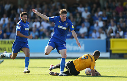 Jonson Clarke-Harris of Bristol Rovers is bundled over by Ryan Delaney of AFC Wimbledon - Mandatory by-line: Arron Gent/JMP - 21/09/2019 - FOOTBALL - Cherry Red Records Stadium - Kingston upon Thames, England - AFC Wimbledon v Bristol Rovers - Sky Bet League One