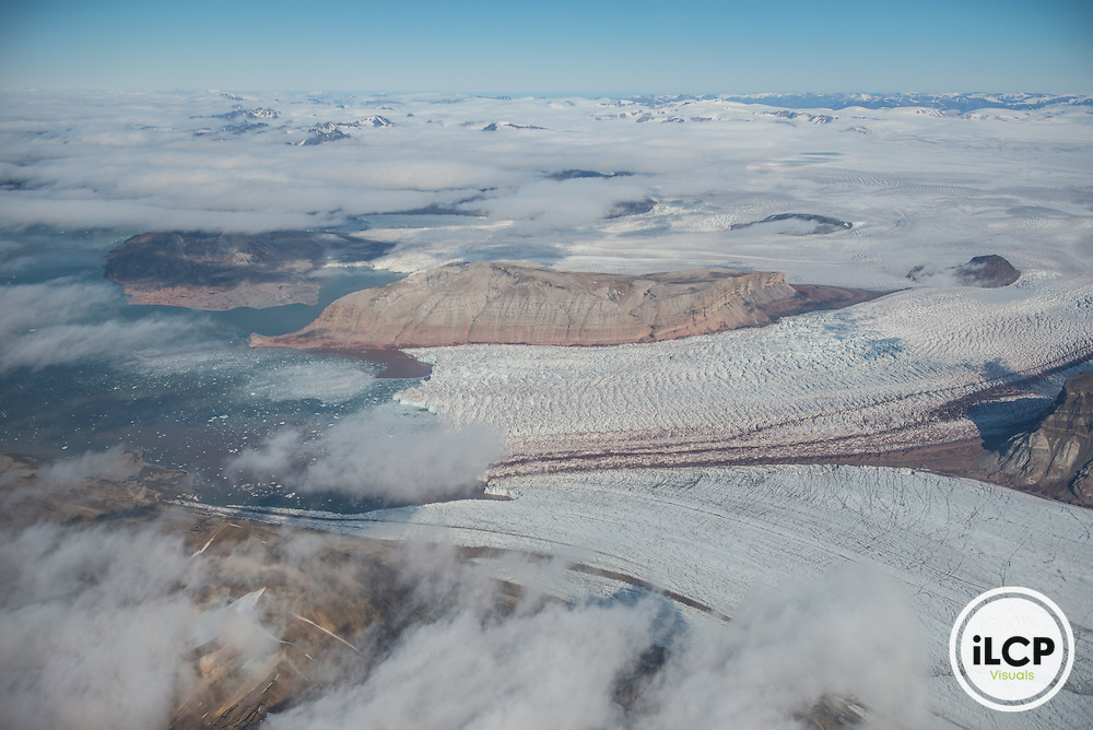 Flying over a melting glacier at Svalbard after finishing the ice thickness measurement survey. Svalbard, Norway, July 29, 2016, Esther Horvath / iLCP