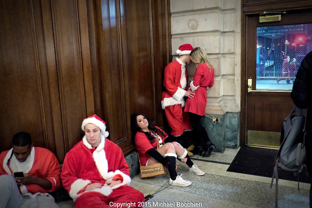 HOBOKEN, NJ - December 19:  People dressed as Santa Claus wait for a train in Hoboken Terminal on December 19, 2015 in HOBOKEN, NJ.  (Photo by Michael Bocchieri/Bocchieri Archive)