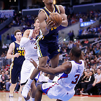 23 October 2013: Los Angeles Clippers point guard Chris Paul (3) takes the hit as a charging foul is called on Utah Jazz power forward Utah Jazz point guard Alec Burks (10) during the Los Angeles Clippers 103-99 victory over the Utah Jazz at the Staples Center, Los Angeles, California, USA.