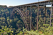 "The New River Gorge Bridge, a part of US Highway 19, is a steel-arch bridge, in Fayetteville, West Virginia, USA. With a length of 3030 feet (924 m), it was for many years the longest in the world of that type. Its arch extends 1700 feet (518 m). BASE jumping is allowed on ""Bridge Day"" held every October on the third Saturday, but Bungee jumping has been banned from Bridge Day since an accident in 1993. The New River Gorge National River is a unit of the United States National Park Service designed to protect and maintain the New River Gorge in southern West Virginia, USA. Established in 1978, the area stretches for 53 miles (85 km) from just downstream of Hinton to Hawks Nest State Park near Ansted."