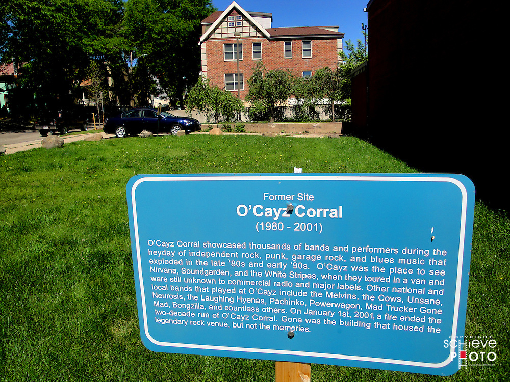 This sign makes the former site of O'Cayz Corral, a small Madison, Wisconsin music club that hosted up-coming bands like Nirvana, Soundgarden, The White Stripes and others.