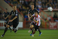 EXETER, ENGLAND - Wednesday, August 24, 2011: Liverpool's Martin Skrtel in action against Exeter City's Daniel Nardiello during the Football League Cup 2nd Round match at St James Park. (Pic by David Rawcliffe/Propaganda)