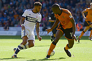 Middlesbrough defender Cyrus Christie (22) takes on Wolverhampton Wanderers defender Willy Boly (15) 1-0 during the EFL Sky Bet Championship match between Wolverhampton Wanderers and Middlesbrough at Molineux, Wolverhampton, England on 5 August 2017. Photo by Alan Franklin.