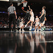 Keith Appling, Michigan State, drives to the basket during the Virginia Cavaliers Vs Michigan State Spartans basketball game during the 2014 NCAA Division 1 Men's Basketball Championship, East Regional at Madison Square Garden, New York, USA. 28th March 2014. Photo Tim Clayton