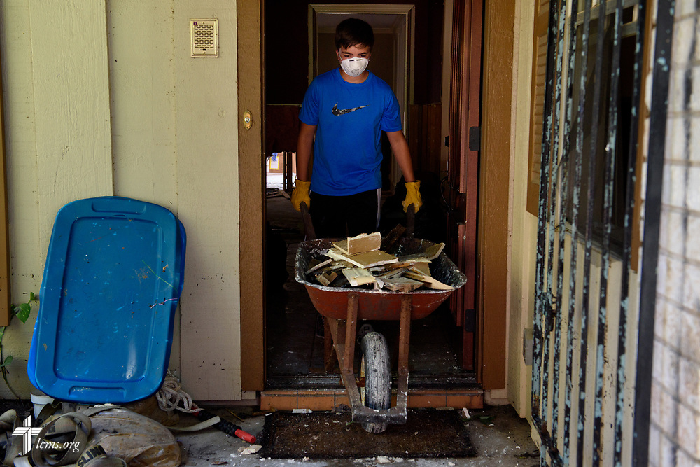 Clayton Turner, a volunteer from Memorial Lutheran Church, Katy, Texas, hauls drywall from a home damaged by Hurricane Harvey on Friday, Sept. 1, 2017, in Katy.  LCMS Communications/Erik M. Lunsford
