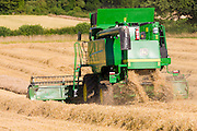 Combine harvester at work in wheat field near Shipton-under-Wychwood